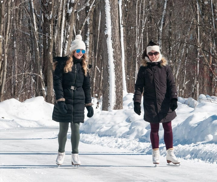 two women skating on the trail